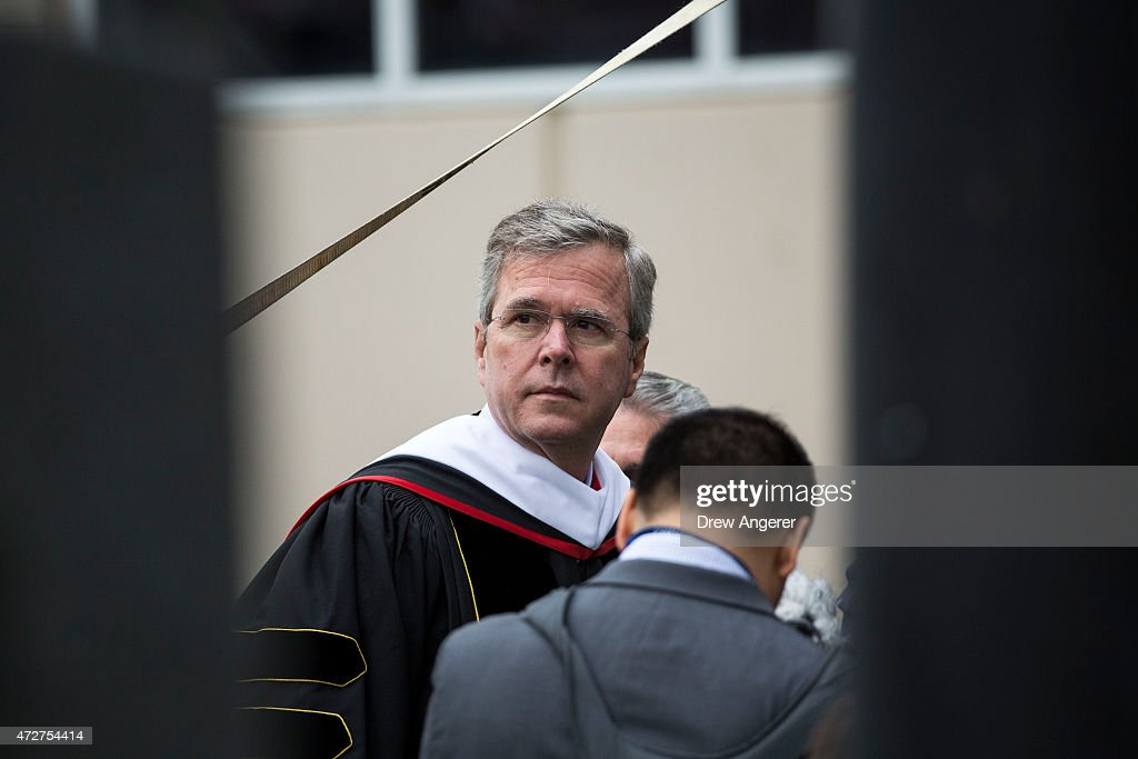 Republican US presidential hopeful and former Florida governor Jeb Bush waits to take the stage prior to delivering the commencement address at...
