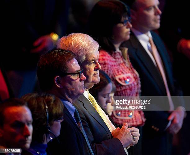 Republican US Presidential hopeful and former Speaker of the US House of Representatives Newt Gingrich stands with members of the congregation during...