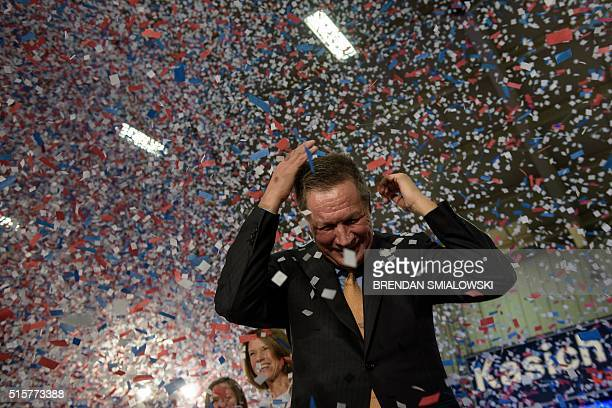 TOPSHOT Republican US Presidential hopeful Ohio Governor John Kasich celebrates his Ohio primary victory during voting day rally at Baldwin Wallace...