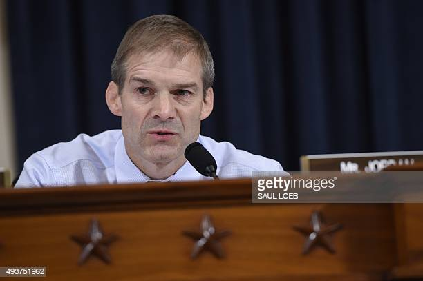 Republican US Representative from Ohio Jim Jordan questions former US Secretary of State and Democratic Presidential hopeful Hillary Clinton as she...