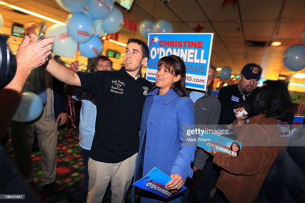 Republican US Senate candidate Christine O'Donnell greets people during a campaign stop at the First State Bowling Center on November 1 2010 in...