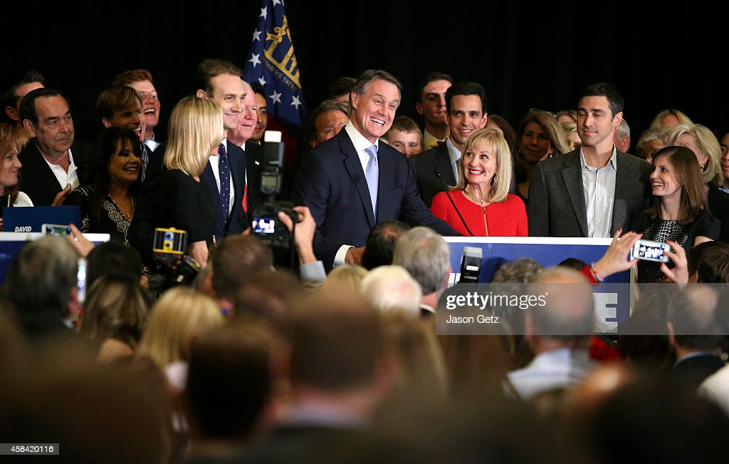 Republican U.S. Senate candidate <a gi-track='captionPersonalityLinkClicked' href=/galleries/search?phrase=David+Perdue&family=editorial&specificpeople=4276858 ng-click='$event.stopPropagation()'>David Perdue</a> celebrates his win with his wife Bonnie at the InterContinental Buckhead November 4, 2014 in Atlanta, Georgia. Perdue defeated Democratic challenger Michelle Nunn.