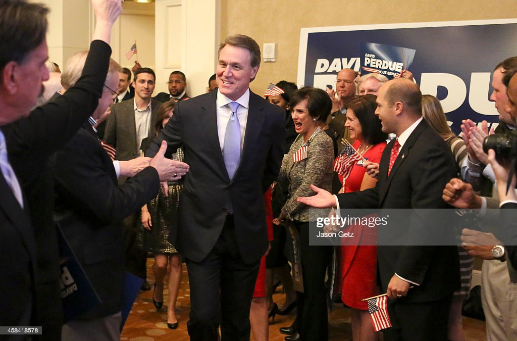 Republican U.S. Senate candidate <a gi-track='captionPersonalityLinkClicked' href=/galleries/search?phrase=David+Perdue&family=editorial&specificpeople=4276858 ng-click='$event.stopPropagation()'>David Perdue</a> enters his election party to celebrate his win at the InterContinental Buckhead November 4, 2014 in Atlanta, Georgia. Perdue defeated Democratic challenger Michelle Nunn.
