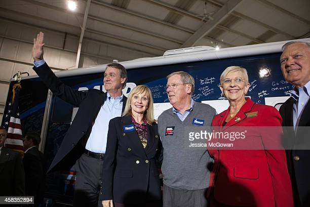 Republican US Senate candidate David Perdue with wife Bonnie retiring US Sen Johnny Isakson Sandra Deal and Georgia Gov Nathan Deal waves to the...