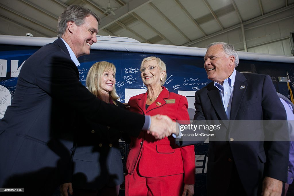 Republican U.S. Senate candidate <a gi-track='captionPersonalityLinkClicked' href=/galleries/search?phrase=David+Perdue&family=editorial&specificpeople=4276858 ng-click='$event.stopPropagation()'>David Perdue</a> with wife, Bonnie, shakes hands with Sandra Deal and Georgia Gov. <a gi-track='captionPersonalityLinkClicked' href=/galleries/search?phrase=Nathan+Deal&family=editorial&specificpeople=2365923 ng-click='$event.stopPropagation()'>Nathan Deal</a> during a campaign stop one day before the midterm elections at Peachtree Dekalb Airport on November 3, 2014 in Atlanta, Georgia. Perdue is in a tight race with Democratic challenger Michelle Nunn.