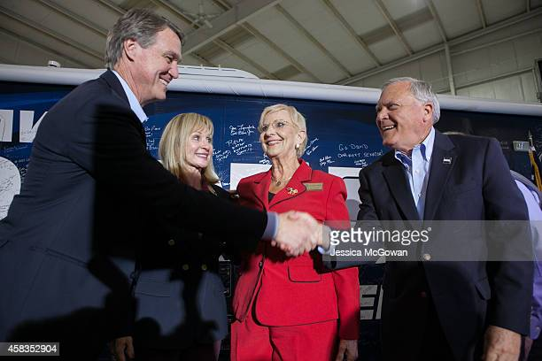 Republican US Senate candidate David Perdue with wife Bonnie shakes hands with Sandra Deal and Georgia Gov Nathan Deal during a campaign stop one day...