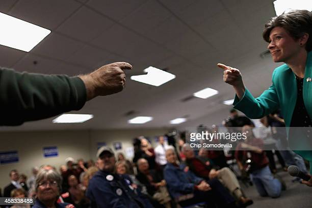 Republican US Senate candidate Joni Ernst trades compliments with a supporter while addressing a crowd at the Johnson County GOP Victory Office...