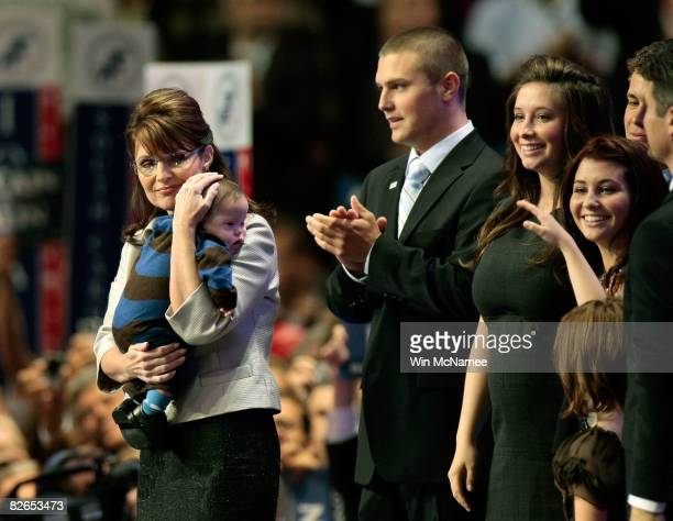 Republican US vicepresidential nominee Alaska Gov Sarah Palin holds her son Trig Palin as Track Palin Bristol Palin and Willow Palin look on during...