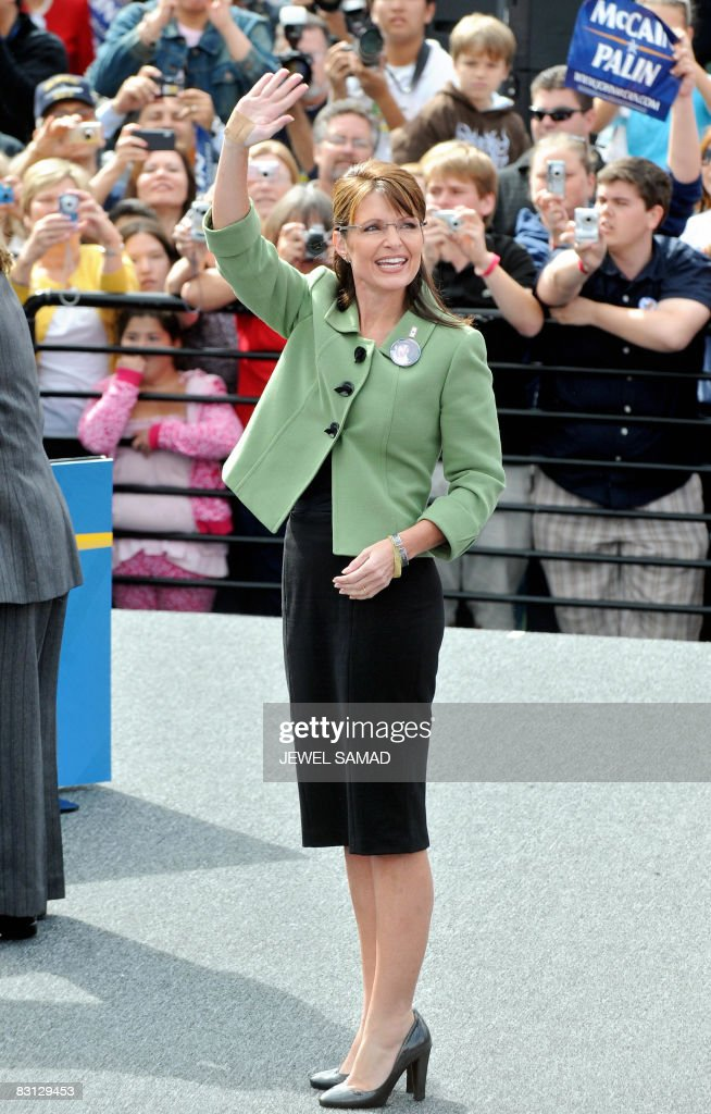 Republican vice presidential cadidate Sarah Palin waves at her supporters as she arrives for a campaign rally at the Home Depot Center in Carson on...