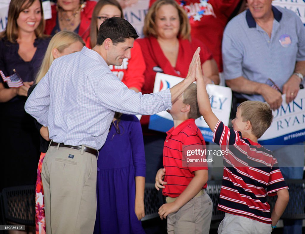 Republican vice presidential candidate and Wisconsin native Rep. Paul Ryan (R-WI) high-fives his son during a campaign event at the Waukesha Expo Center on August 12, 2012 in Waukesha, Wisconsin. Romney continues his four day bus tour a day after announcing his running mate, Rep. Paul Ryan.