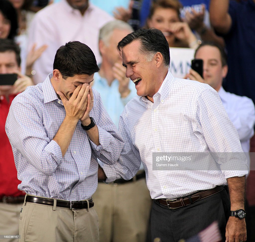 Republican vice presidential candidate and Wisconsin native Rep. Paul Ryan (R-WI) (L) wipes away tears as he and presidential candidate and former Massachusetts Gov. <a gi-track='captionPersonalityLinkClicked' href=/galleries/search?phrase=Mitt+Romney&family=editorial&specificpeople=207106 ng-click='$event.stopPropagation()'>Mitt Romney</a> greet supporters during a campaign event at the Waukesha Expo Center on August 12, 2012 in Waukesha, Wisconsin. Romney continues his four day bus tour a day after announcing his running mate, Rep. Paul Ryan.