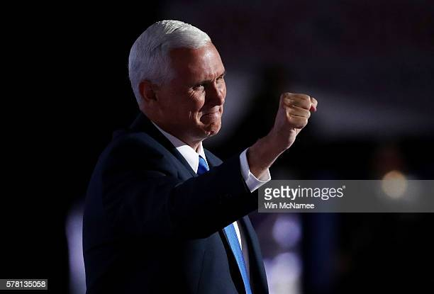 Republican Vice Presidential candidate Mike Pence gestures to the crowd as he walks on stage to deliver a speech on the third day of the Republican...