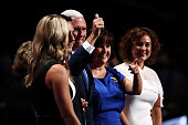 Republican vice presidential candidate Mike Pence gives a thumbs up to the crowd while accompanied by his mother Nancy Pence his daughter Audrey...