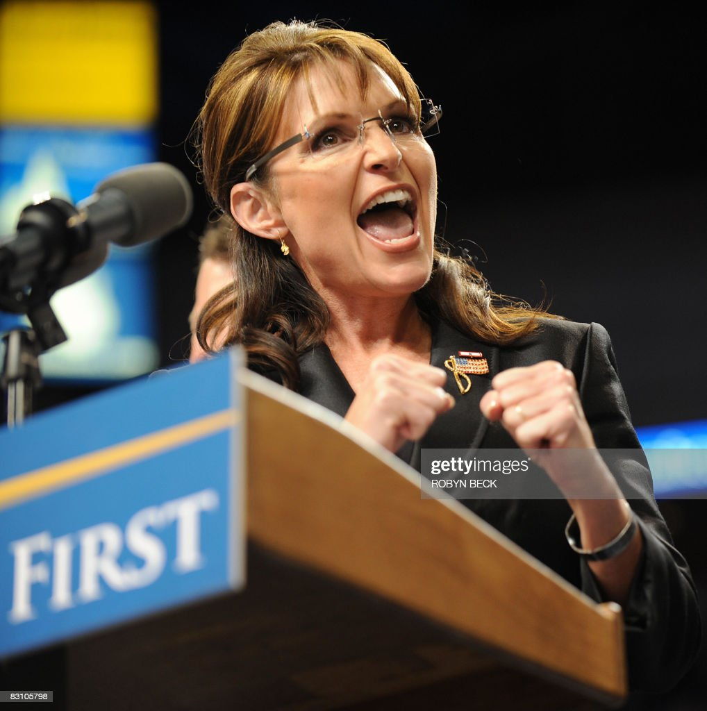 Republican vice presidential candidate Sarah Palin responds to cheers upon her arrival for a post-debate rally at St. Louis University's Chaifetz Arena in St. Louis, Missouri on October 02, 2008. Palin received a rock-star welcome at the rally after holding her own in a highly-anticipated US vice presidential debate with Democrat Joseph Biden. AFP PHOTO / Robyn BECK