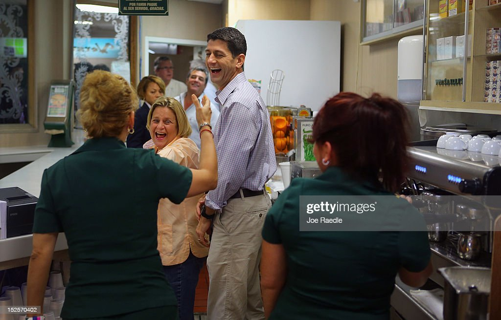 Republican vice presidential candidate, U.S. Rep. Paul Ryan (R-WI) and Rep. <a gi-track='captionPersonalityLinkClicked' href=/galleries/search?phrase=Ileana+Ros-Lehtinen&family=editorial&specificpeople=588095 ng-click='$event.stopPropagation()'>Ileana Ros-Lehtinen</a> (R-FL) share a laugh with waitress, Lourdes Alcerro, during a campaign stop at Versailles restaurant in the Little Havana neighborhood on September 22, 2012 in Miami, Florida. Ryan continues to campaign for votes across the country.