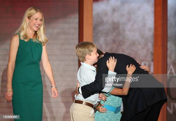Republican vice presidential candidate US Rep Paul Ryan hugs his children daughter Liza Ryan and sons Charlie Ryan and Sam Ryan with wife Janna Ryan...