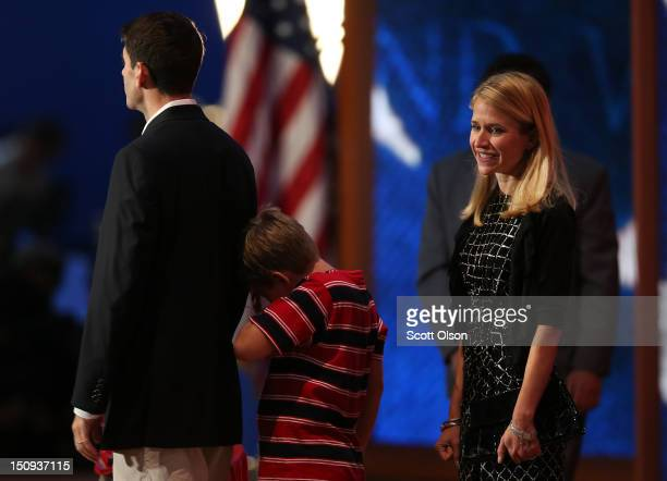 Republican vice presidential candidate US Rep Paul Ryan stands his son Charlie Ryan wife Janna Ryan during a soundcheck during the third day of the...