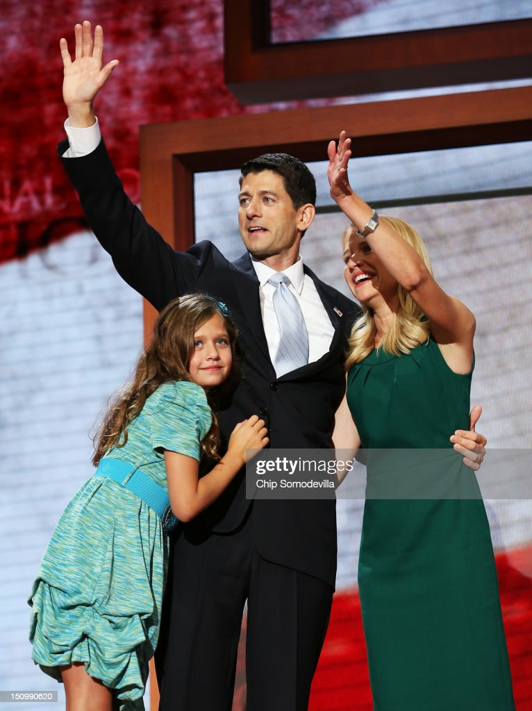 Republican vice presidential candidate, U.S. Rep. Paul Ryan (R-WI) waves with his wife, <a gi-track='captionPersonalityLinkClicked' href=/galleries/search?phrase=Janna+Ryan&family=editorial&specificpeople=9632767 ng-click='$event.stopPropagation()'>Janna Ryan</a> and daughter Liza Ryan during the third day of the Republican National Convention at the Tampa Bay Times Forum on August 29, 2012 in Tampa, Florida. Former Massachusetts Gov. Mitt Romney was nominated as the Republican presidential candidate during the RNC, which is scheduled to conclude August 30.