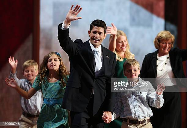 Republican vice presidential candidate US Rep Paul Ryan waves with his family daughter Liza Ryan sons Charlie Ryan and Sam Ryan wife Janna Ryan and...