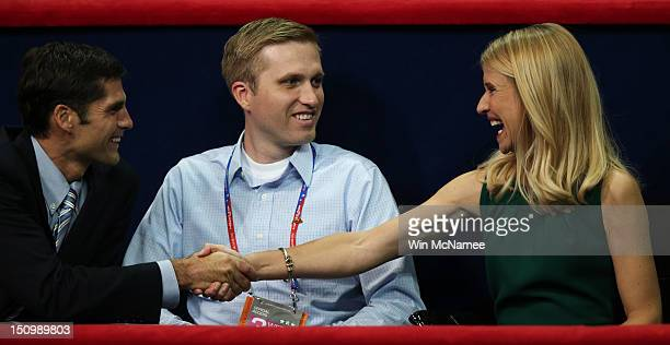Republican vice presidential candidate US Rep Paul Ryan's wife Janna Ryan shakes hands with Matt Romney during the third day of the Republican...