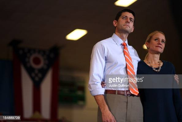 Republican vice presidential candidate US Sen Paul Ryan and his wife Janna Ryan listen as Republican presidential candidate former Massachusetts Gov...