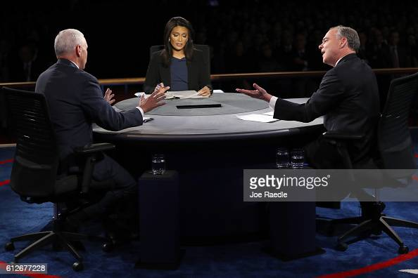 Republican vice presidential nominee Mike Pence and Democratic vice presidential nominee Tim Kaine debate as moderator Elaine Quijano listens during...