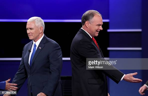 Republican vice presidential nominee Mike Pence and Democratic vice presidential nominee Tim Kaine stand on stage following the Vice Presidential...