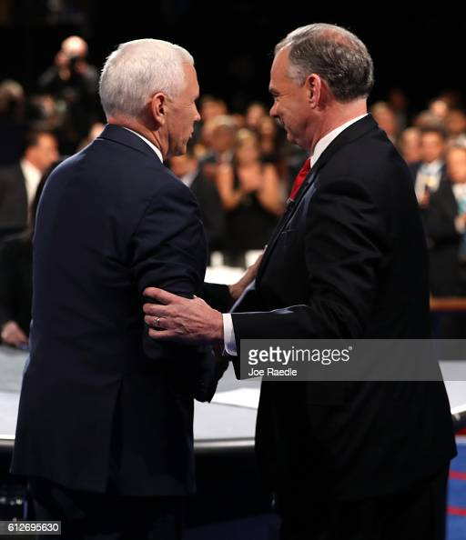 Republican vice presidential nominee Mike Pence and Democratic vice presidential nominee Tim Kaine shake hands on stage following the Vice...