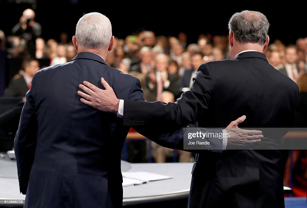 Republican vice presidential nominee Mike Pence and Democratic vice presidential nominee Tim Kaine meet on stage following the Vice Presidential...