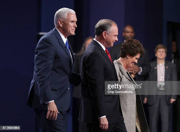 Republican vice presidential nominee Mike Pence Democratic vice presidential nominee Tim Kaine and his wife Anne Holton stand on stage following the...