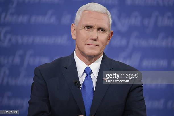 Republican vice presidential nominee Mike Pence listens during the Vice Presidential Debate with Democratic vice presidential nominee Tim Kaine at...