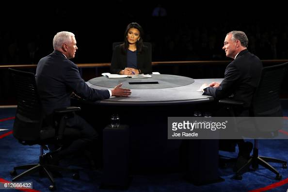 Republican vice presidential nominee Mike Pence speaks as Democratic vice presidential nominee Tim Kaine and debate moderator Elaine Quijano listen...