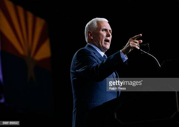 Republican vice presidential nominee Mike Pence speaks to a crowd of supporters at a campaign rally for presidential nominee Donald Trump on August...