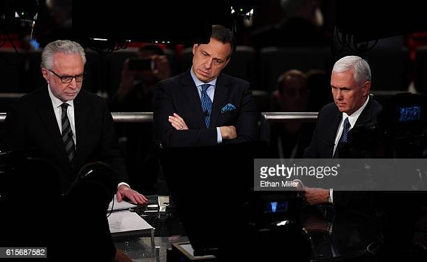 Republican vice presidential nominee Mike Pence speaks with the CNN's Wolf Blitzer and Jake Tapper prior to the start of the third US presidential...