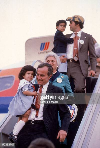 Republican VP candidate George Bush w granddaughter Noelle wife Barbara and son Jeb w his son George disembarking fr plane