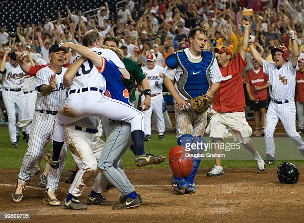 Republican's celebrate after Adam Putnam RFl scored the winning run as the democratic catcher Christopher Murphy DConn gets out of the way during the...