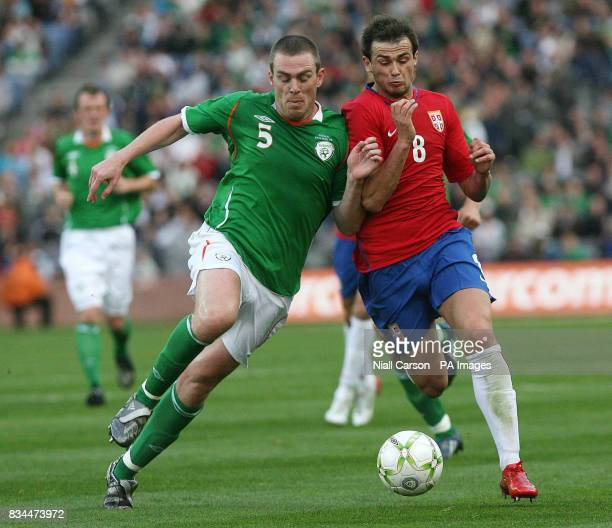 Republic's Richard Dunne tackles Sebia's Danko Lazovic during the International match at Croke Park Dublin