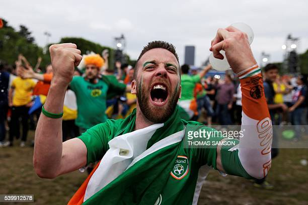 TOPSHOT Repulic of Ireland supporters react as they watch the Euro 2016 group E football match between Republic of Ireland and Sweden in a fan zone...