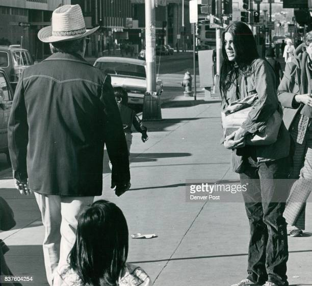 A request for spare change by panhandlerreporter Betsy Howard is turned down by an unidentified man left The scene is in front of Wooldworth's on...