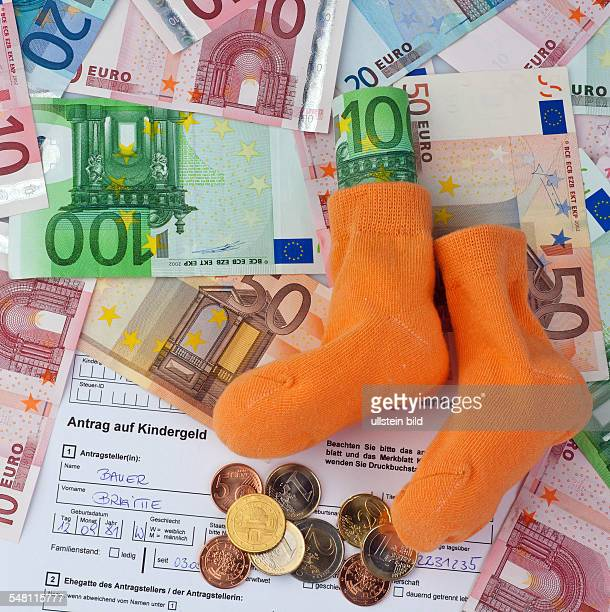 request of child benefit baby socks and Euro banknotes and coins