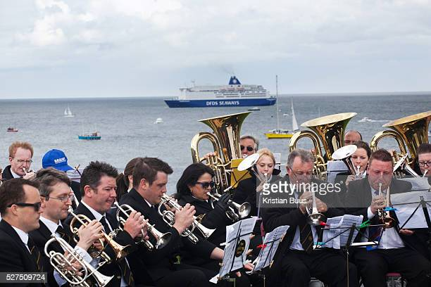 A Requiem For The Foghorn performed by a seventy five piece brass band a foghorn and an armada of ships playing their remote controlled foghorns A...