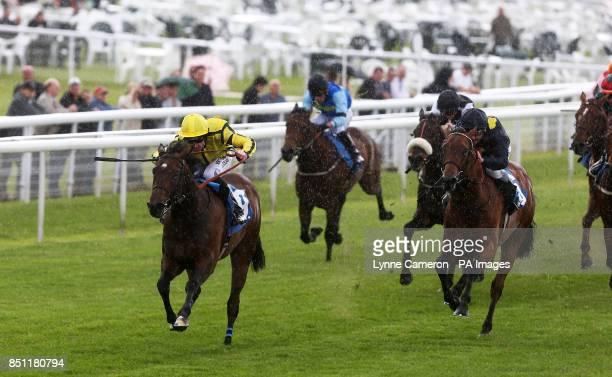 Reroute ridden by Robert Winston wins the McArthurglen York Designer Outlet EBF Maiden Stakes at York Racecourse York
