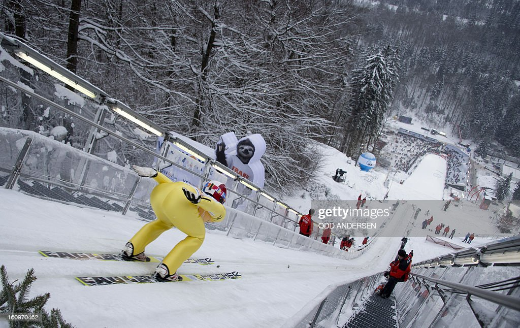 Reruhi Shimizu of Japan jumps during the training run at the FIS Ski Jumping World Cup on the Muehlenkopfschanze hill in Willingen, western Germany, on February 8, 2013. Heavy snowfall made the conditions challenging for the athletes.