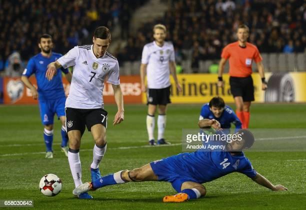 Resad Sadigov of Azerbaijan in action against Julian Draxler of Germany during the 2018 FIFA World Cup European Qualifying match between Azerbaijan...