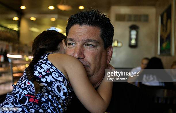 Rescue 5 firefighter Joey Esposito holds his daughter Jolie in a Staten Island diner on July 5 2011 Joeywho began as a firefighter in August is one...