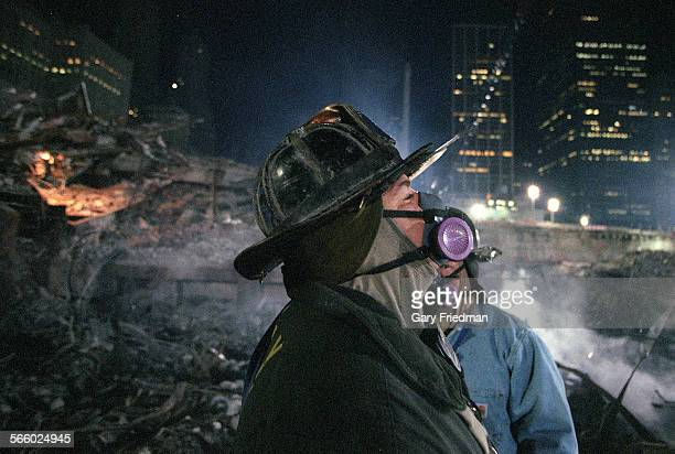 Rescue 5 firefighter Joey Esposito on the 'pile' at Ground Zero searching for victims of the WTC in December 2001 Eleven members of Joey's company...