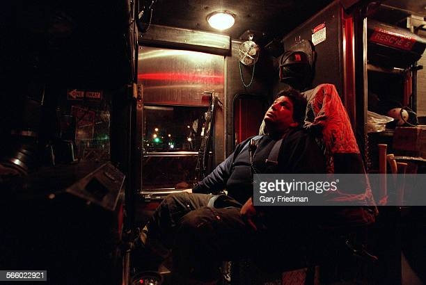 Rescue 5 firefighter Joey Esposito sits in the rig after returning and searching from the WTC Ground zero site in December 2001 Eleven members of...