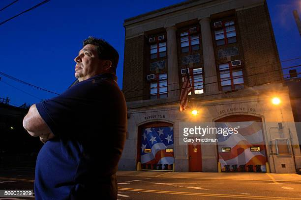 Rescue 5 firefighter Joey Esposito stands in front of the Rescue 5/Engine 160 firehouse on July 5 2011 Painted on the firehouse doors are eleven...