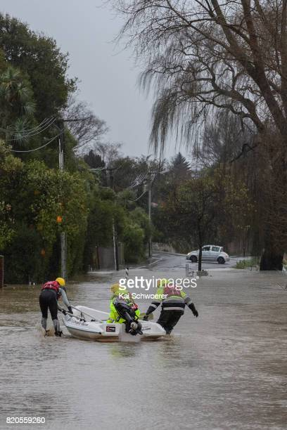 A rescue boat is seen as rising waters cause flooding in Fifield Terrace in the suburb of Opawa on July 22 2017 in Christchurch New Zealand Heavy...