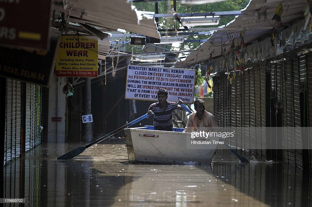 A rescue boat sailing through the water logged lanes during flood in river Yamuna on June 20, 2013 in New Delhi, India. Low-lying areas along the Yamuna remained submerged for the second consecutive day though the water level in the river started receding today.
